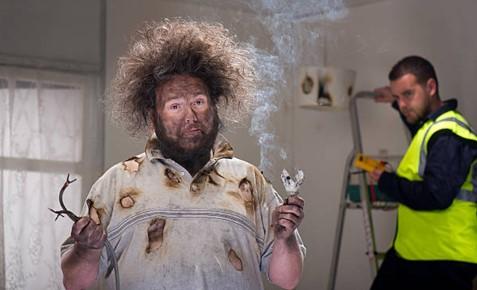 man with broken electrical equipment