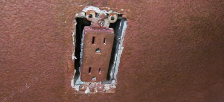 painted over electrical outlet